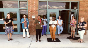 FES Staff Receives Harvey's Gift Cards