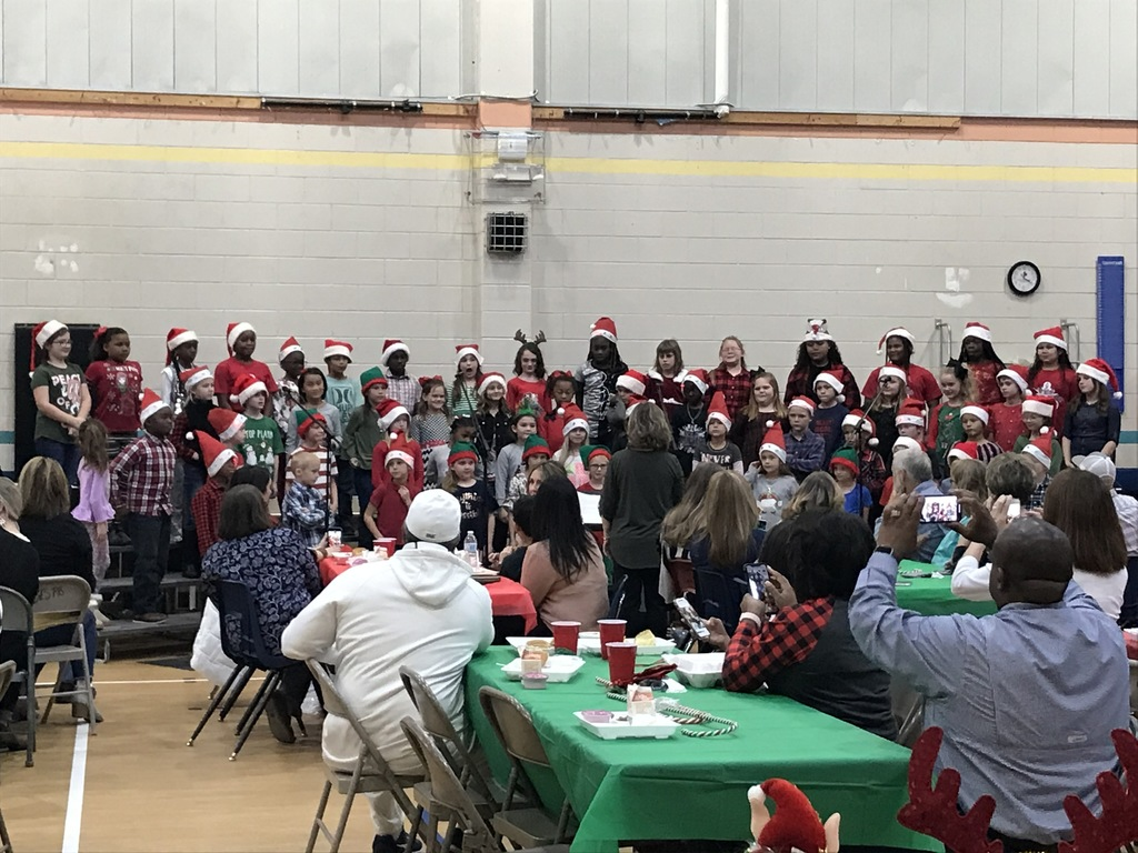 Students singing at Christmas Luncheon